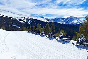 Grand Adventures Snowmobile Tours & Rentals :: Guided tours & unguided rentals in Winter Park & Grand Lake. Beginner, Intermediate, & kids welcome! Free suit rental with guided tour or rental. Book now for the best rates!